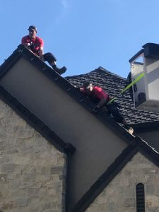Safely hanging lights on tall roofs